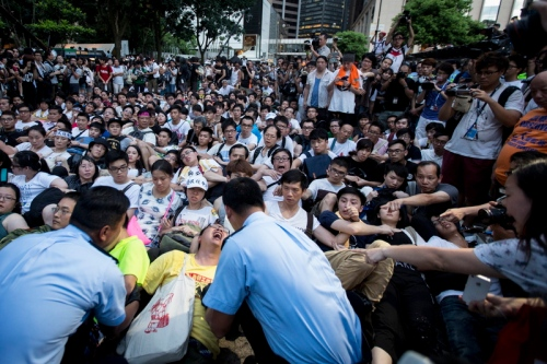 Hong Kong police arrest pro-democracy protesters