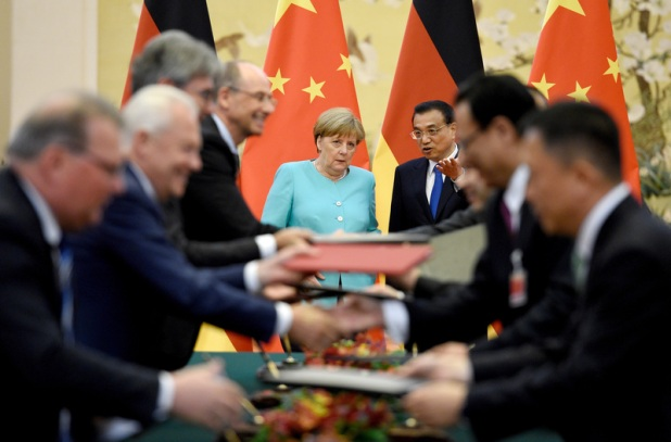 German Chancellor Angela Merkel and Chinese Prime Minister Li Keqiang look on on Monday as a series of economic and diplomatic agreements are signed. Merkel used her three-day visit to assure China that Germany was in its court as China tries to bolster its global trading ties. dpa/Rainer Jensen