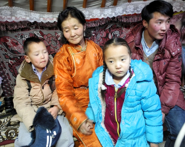 Ariunaa Zinameder, 54, and her family inside their traditional home, called a ger, in the province of Bayanghongor, Mongolia, February 23, 2016. The family subsists on 36 dollars  worth of food stamps a month and is part of Mongolia's increasing number of impoverished. PHOTO/JOANNA CHIU