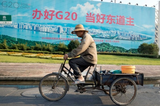 "HOLD FOR STORY G20 CHINA HOST'S IMAGE BY CHRIS BODEEN A man cycles past a propaganda board with the words ""Organize well G20, be a good host"" in Hangzhou in eastern China's Zhejiang province on Thursday, Sept. 1, 2016. China's hosting of the Group of 20 industrialized nations summit highlights its role as the world's second largest economy and a growing force in global diplomacy, but also comes amid sharpening frictions over its territorial claims in the South China Sea, disputes with fellow regional powers South Korea and Japan and criticisms over a sweeping crackdown on dissent at home. China hopes to avoid discussion of such issues while using the summit in the eastern city of Hangzhou to burnish its image as a responsible major nation whose support is essential to solving the world's ills. (AP Photo/Ng Han Guan)"